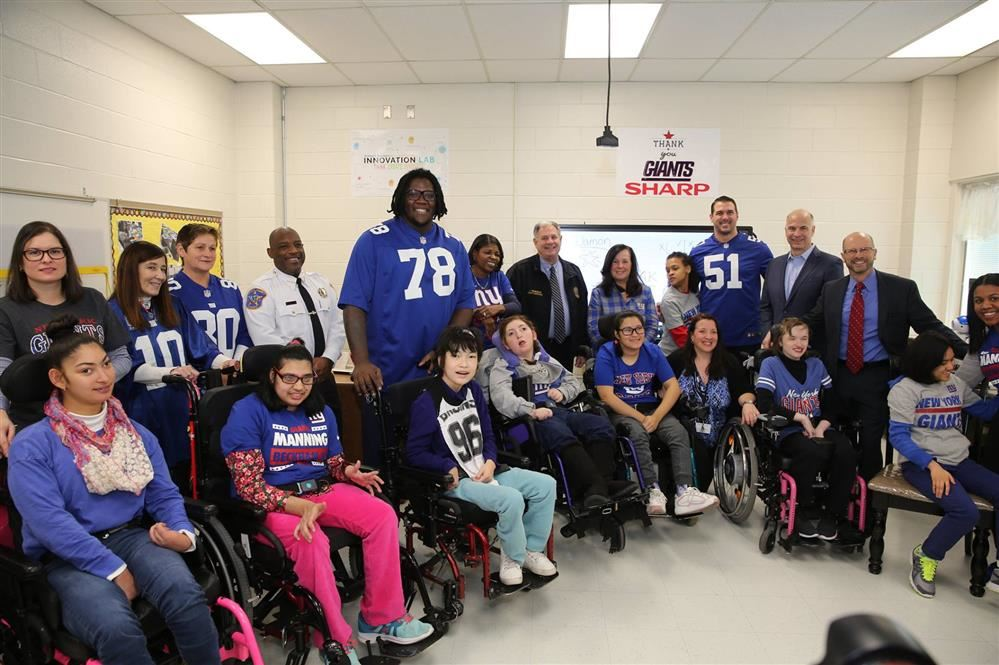 NY Giants and Sharp Donation and Visit